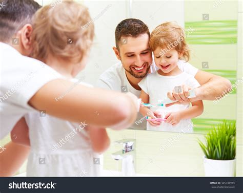 dad daughter in bathroom happy family father daughter child girl stock photo