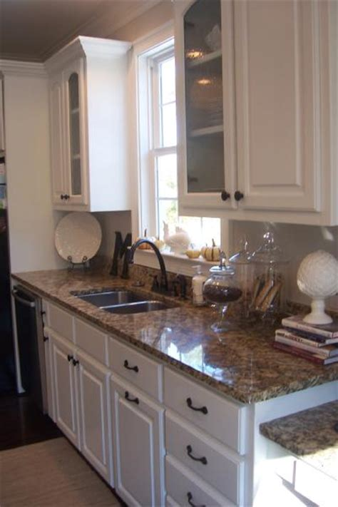 kitchen cabinets and countertops santa cecilia granite with white cabinets
