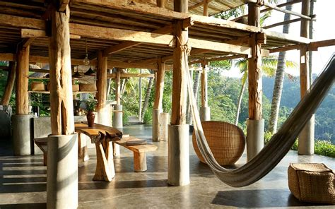 airbnb zen hideaway swing over a waterfall at this riverfront villa in bali