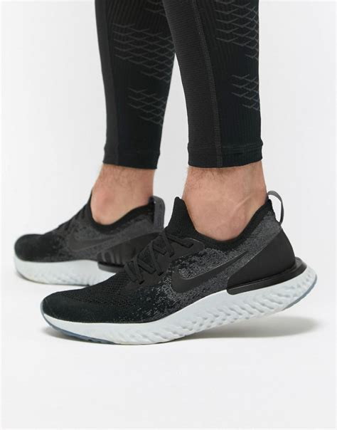 Jual Nike Epic React Black lyst nike epic react flyknit trainers in black aq0067 001 in black