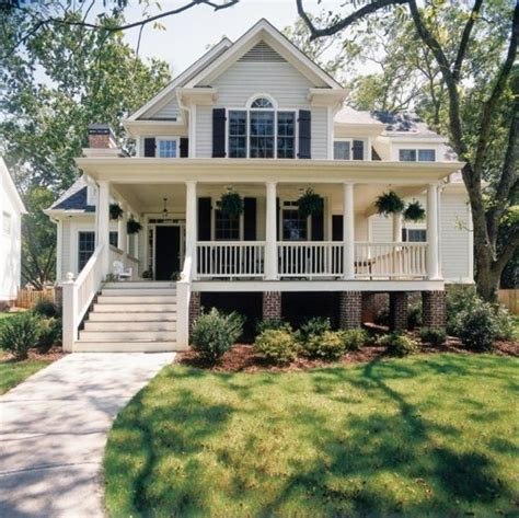 wrap around front porch white home home house steps suburbs shutters front