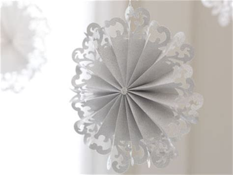 How To Make Hanging Paper Snowflakes - hanging paper snowflakes pottery barn