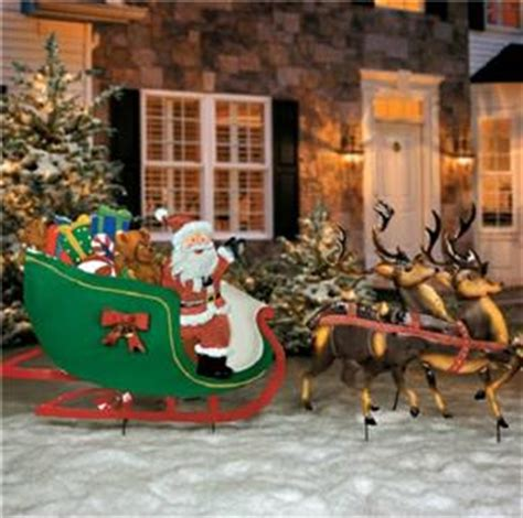 old fashioned santa claus reindeer sleigh metal yard art