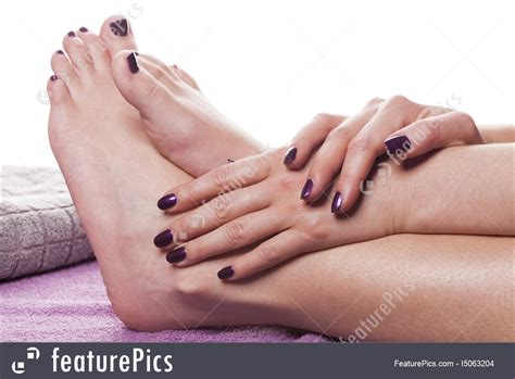 manicured hands  bare feet photo