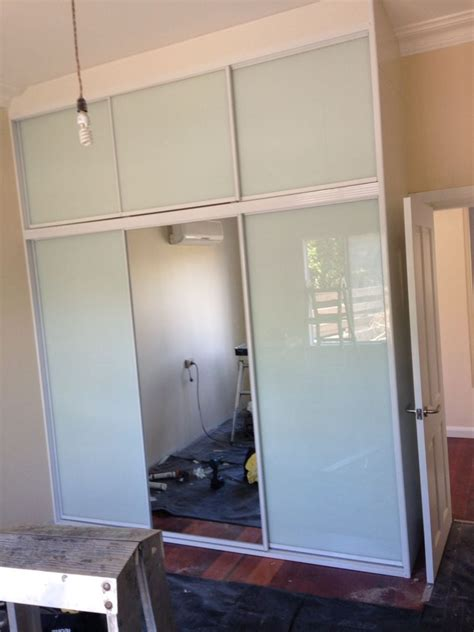 Fantastic Built In Wardrobes by Overhead Sliding Doors Fantastic Built In Wardrobes