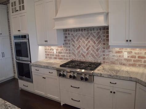 Backsplash Ideas For Kitchen With White Cabinets by Brick Backsplash In The Kitchen Presented With Soft Colors
