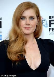 Amy adams flaunts cleavage again at london photocall for her new movie