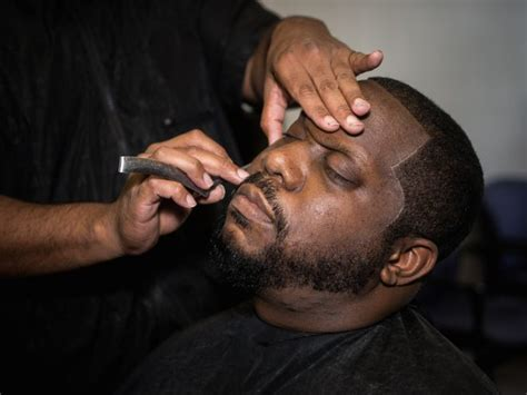 philly fade shave fade and a shave inside philly s black barbershops