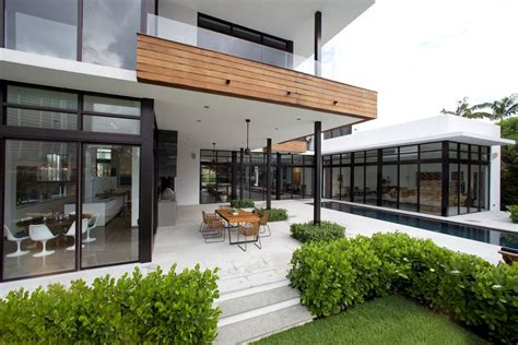 contemporary beach house with terraces idesignarch pool terrace dining table modern home in golden beach
