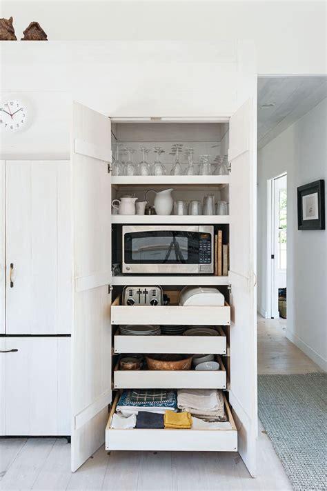 cabinet that hides appliances favorite kitchens pinterest best 25 appliance cabinet ideas on pinterest appliance