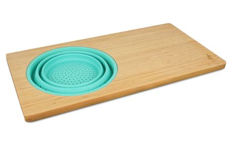 kitchen with cutting board and colander island bamboo over the cutting board with collapsible