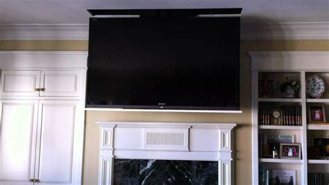 Tv Suspended From Ceiling by Motorized 70 Quot Led Flat Panel Tv Disappears Into Ceiling