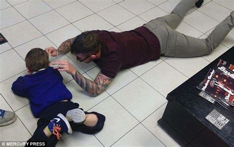 moment a barber lay on the floor to cut an autistic