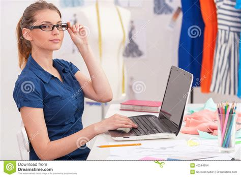 confident fashion designer at work stock photo image