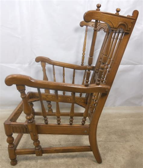 ercol armchairs carved elm upholstered wing armchair old colonial range by ercol