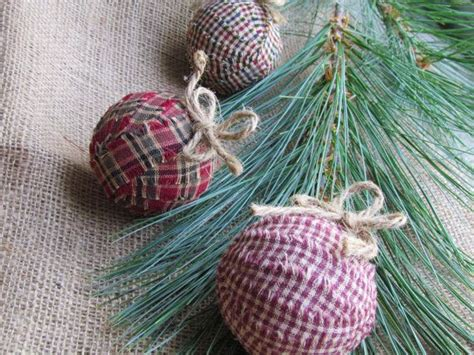christmas tree made out of ornaments three tree ornaments made out of fabric strips and a styrof
