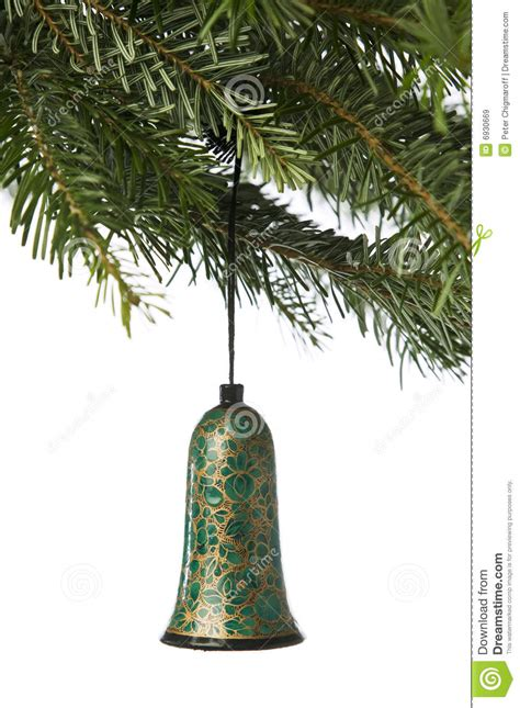 bell ornament hanging from a christmas tree royalty free