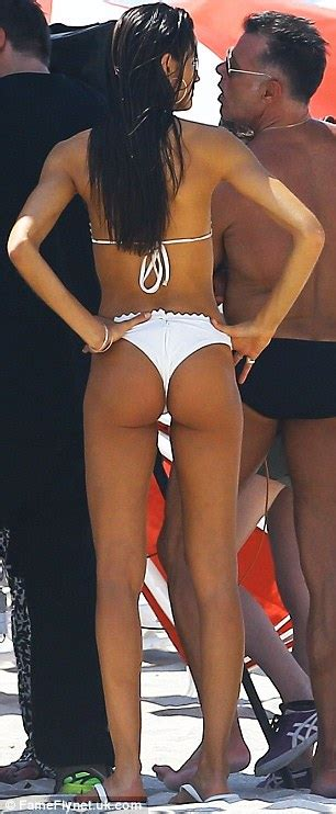 she s a peach izabel goulart nibbles on healthy fruit as she poses