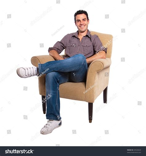 sitting in sofa portrait young man sitting on sofa stock photo 34526629