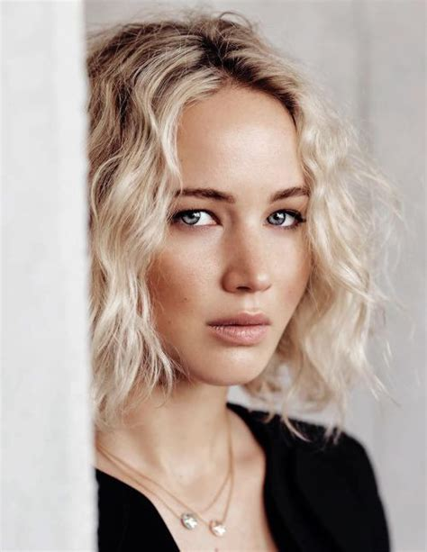 jennifer lawrence with curling iron jennifer lawrence s bob hairstyles hair world magazine
