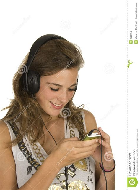 Lovely Mp3 | lovely brunette with mp3 player royalty free stock images