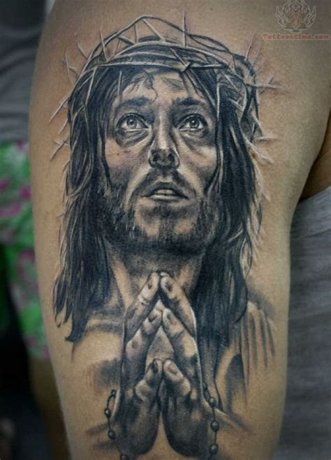 tattoo hand jesus top 25 praying hands tattoos for the faithful