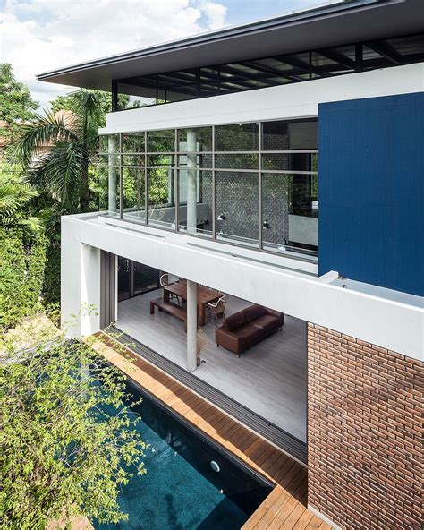 large sliding glass doors and windows open up the thai