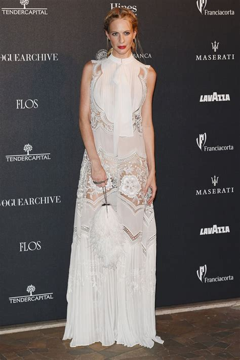 celebrity style gowns poppy delevingne wearing a beautiful white roberto cavalli