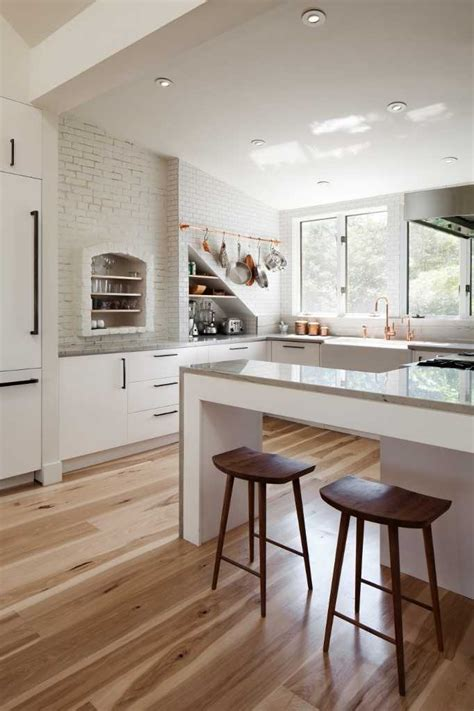 Used Kitchen Cabinets Ma wood flooring warms up a white kitchen