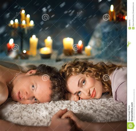 sexy couple in bed sexy young couple lay in bed candles royalty free stock photo image 29834715