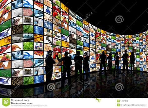People Looking At Wall Of Screens Stock Photography