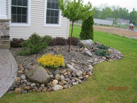 bryk city landscaping installing edger block rock beds