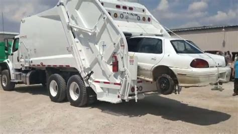 garbage truck compactor crushes  car funnycom
