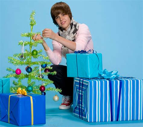 justin bieber to release a christmas album co writes song