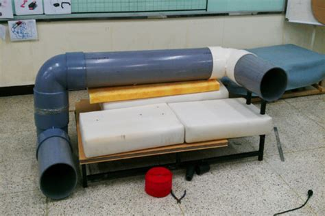tube couch a sofa with a built in tunnel for cats to play in