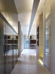 simple modern hallway with mirrored closet storage hgtv