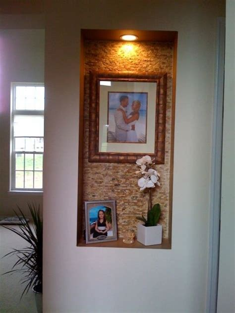wall niche used tile from the tile shop and framed the back wall of the niche and then