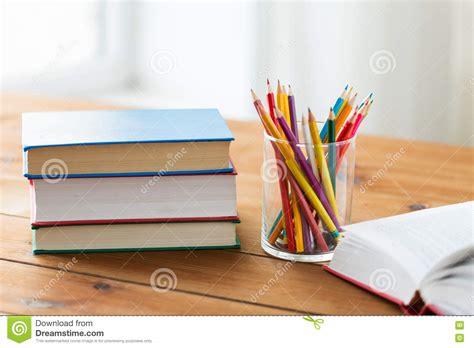 crayons colored pencils coloring book six books up of crayons or color pencils and books stock photo