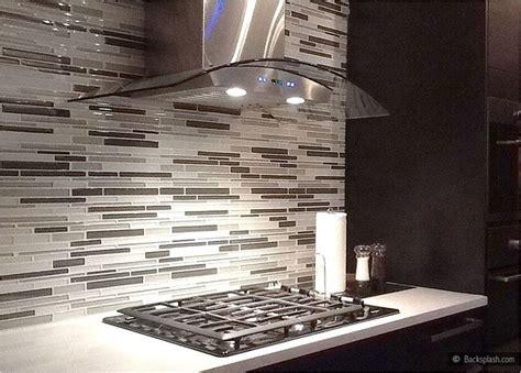 mosaic tile backsplash white cabinets espresso brown dark kichen cabinets white countertop gray