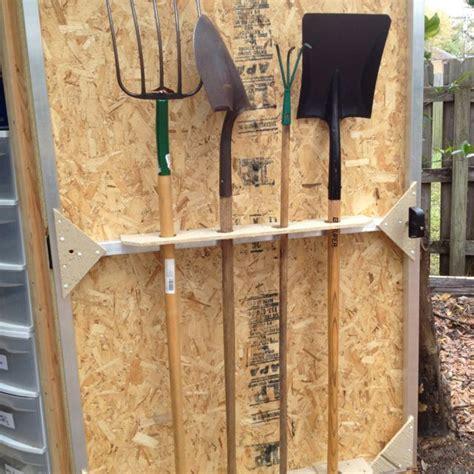 shed door doubles  shovel storage small garden tools
