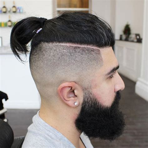 fadeout top knot shaved sides hairstyles for men 2018 men s haircuts