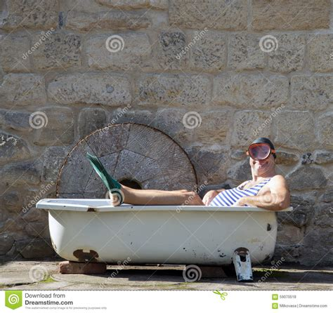 the bathtub man man with snorkeling gear lying in the bathtub stock photo image 59070518