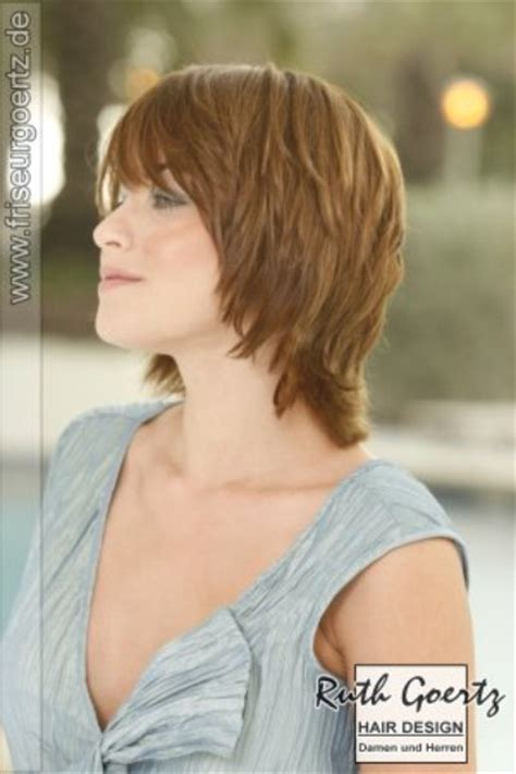 hairstyles images short carefree collar length hairstyle with a long angled fringe