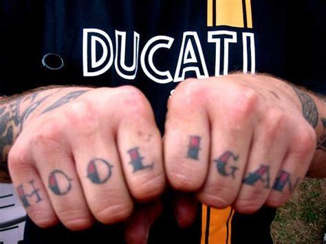 finger tattoos words hool igan words on fingers