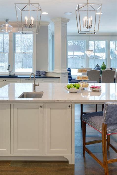 white kitchen island with stools white kitchen cabinets with overlay panel trim