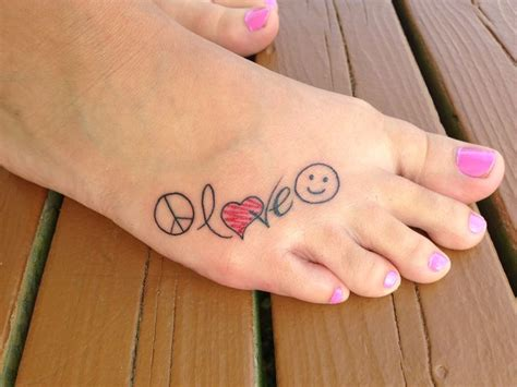 peace love and happiness tattoo peace happiness on my foot tattoos piercings