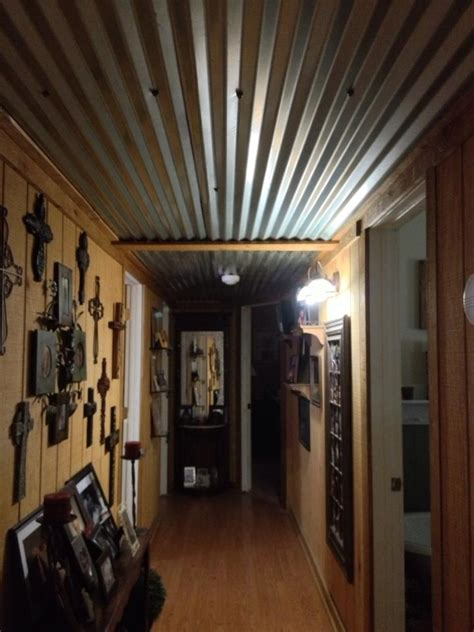 tin ceiling barn tin ceiling in our hallway cabin ideas barn tin hallways and ceilings