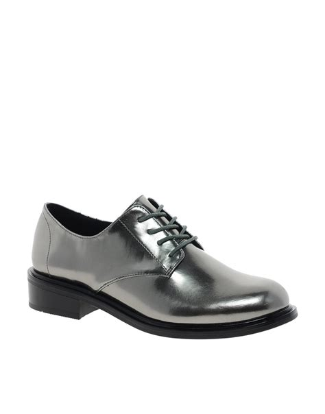 inexpensive flat shoes lyst cheap monday go oxford lace up flat shoes in metallic