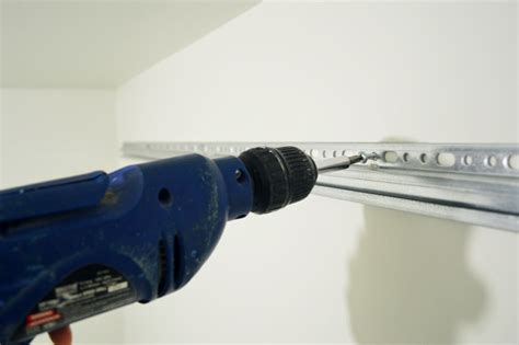 screws to hang ikea wall cabinets how to hang ikea cabinets young house love