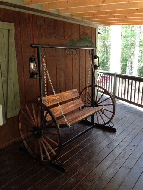 wagon wheel porch swing porch swing with wagon wheel sides and working kerosene